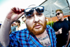 "Action Bronson Talks Beard Products & ""Turning Up"" At Summer Jam"