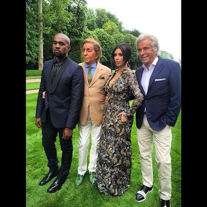 Kanye poses with Kim, Valentino and Giancarlo