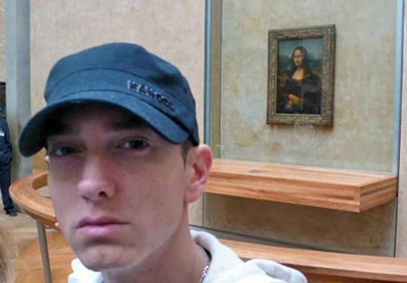Eminem takes a selfie with the Mona Lisa