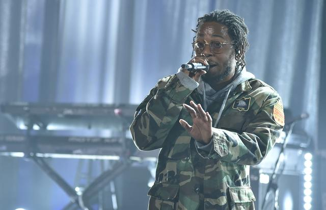 Kendrick Lamar rocking an army jacket