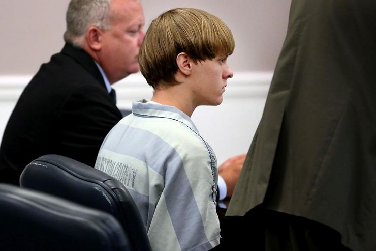 Dylan Roof (C), the suspect in the mass shooting that left nine dead in a Charleston church last month, appears in court July 18, 2015 in Charleston, South Carolina.