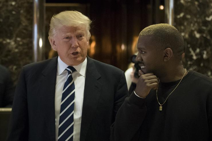 President-elect Donald Trump and Kanye West walk into the lobby at Trump Tower, December 13, 2016 in New York City.