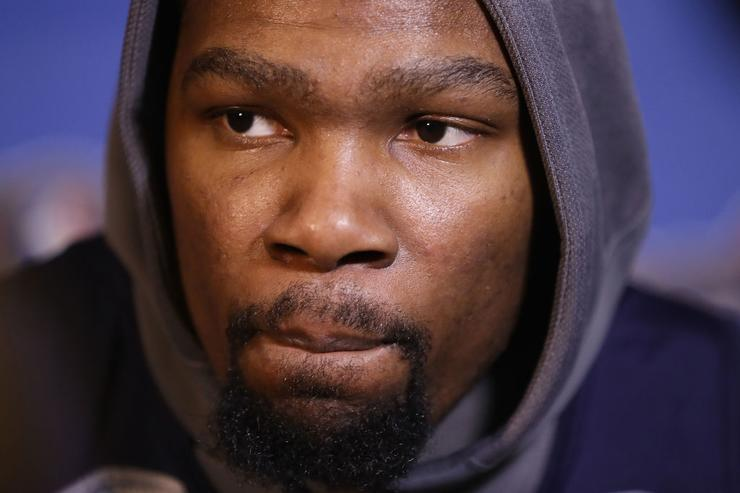 Kevin Durant #35 of the Golden State Warriors speaks with the media after practice for the 2017 NBA All-Star Game at the Mercedes-Benz Superdome on February 18, 2017 in New Orleans, Louisiana.