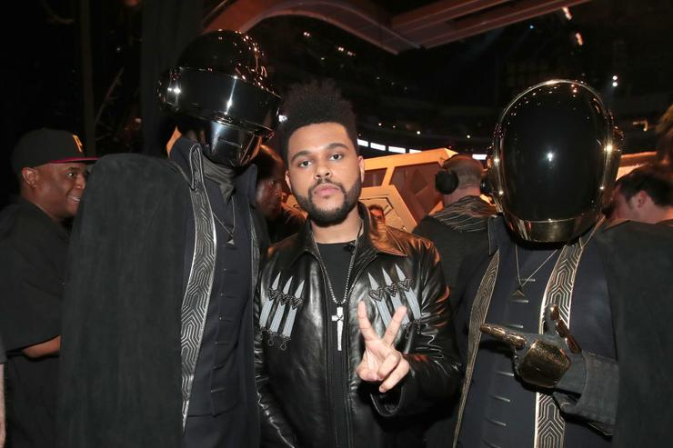 Daft Punk and The Weeknd (C) attend The 59th GRAMMY Awards at STAPLES Center on February 12, 2017 in Los Angeles, California.